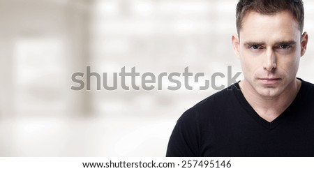 Handsome young man portrait over grey background. - stock photo