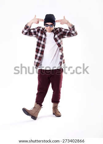 Handsome young man posing in fashionable clothes. Studio shot.
