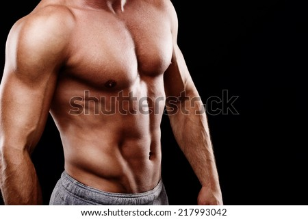 Handsome young man's torso - stock photo