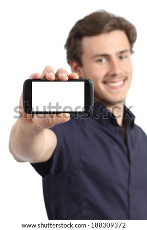 Handsome young man showing a blank smart phone display isolated on a white background          - stock photo