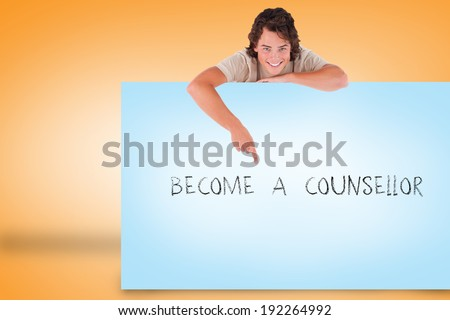 Handsome young man showing card with become a counsellor against orange background - stock photo