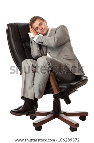 Handsome young man sleeping in an armchair, isolated over white - stock photo