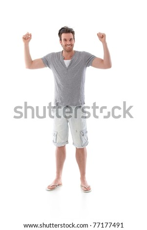 Handsome young man smiling happily at summertime.? - stock photo