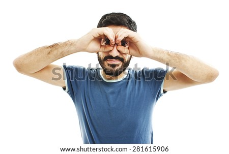 Handsome young man smiling, making binoculars with his hands. Isolated on white background.    - stock photo