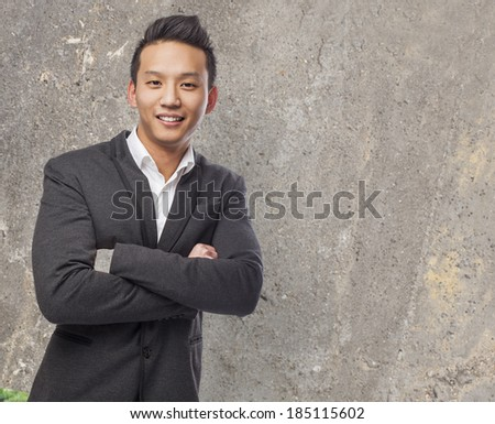 handsome young man standing wearing a suit - stock photo