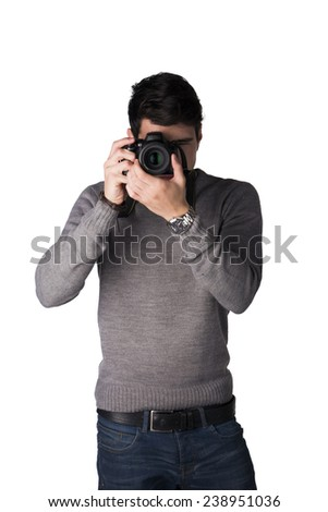 Handsome young man taking photo with professional photo camera, standing isolated on white - stock photo