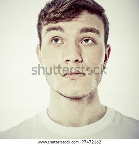 handsome young man thinking - stock photo