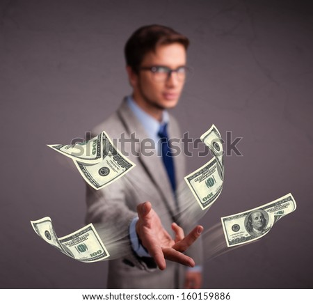 Handsome young man throwing money