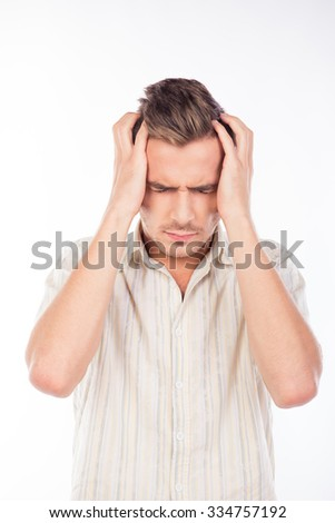 Handsome young man touching his head feeling headache - stock photo