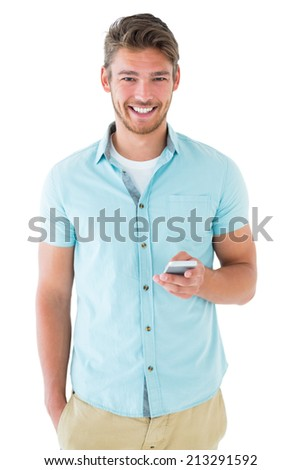 Handsome young man using his smartphone on white background - stock photo