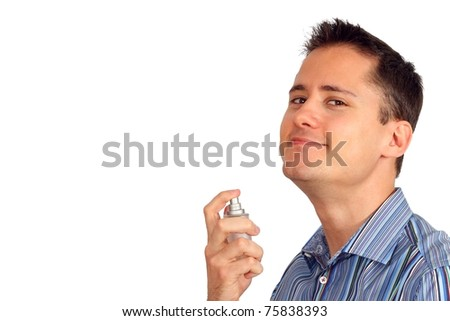 Handsome young man using perfume - stock photo