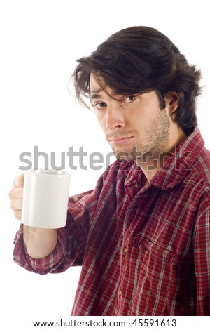Handsome  young man warming up with a hot cup of coffee. Isolated on white.
