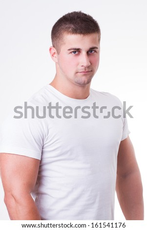 handsome young man wearing white t-shirt - stock photo
