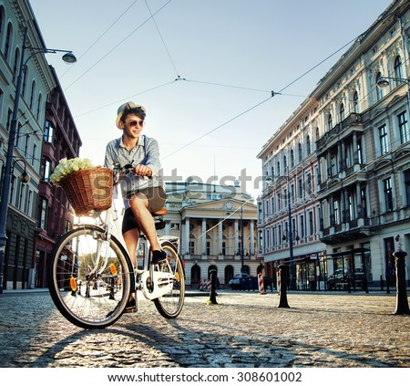 Handsome young man with a stylish bike - stock photo