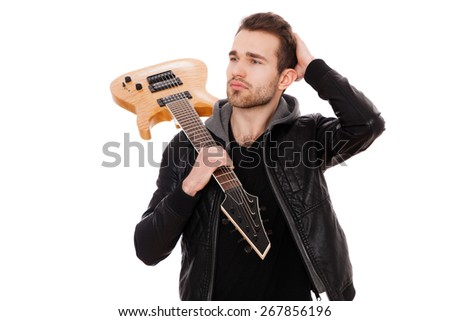 Handsome young man with an electric guitar. - stock photo