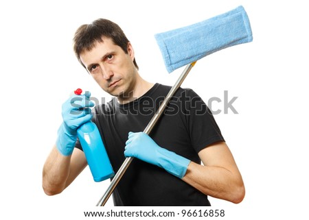 handsome young man with cleaning supplies on white background - stock photo