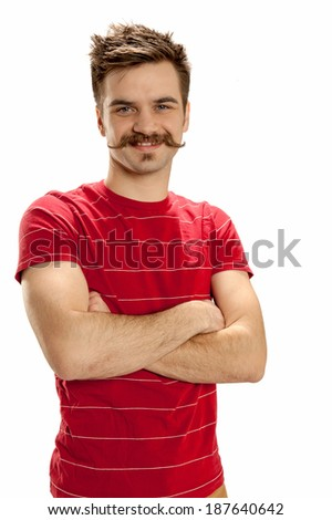 Handsome young man with crossed arms, standing and smiling, isolated on white background - stock photo