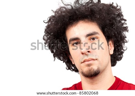 Handsome young man with goatee and long curly hair.
