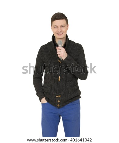Handsome young  man with microphone on the white background. - stock photo