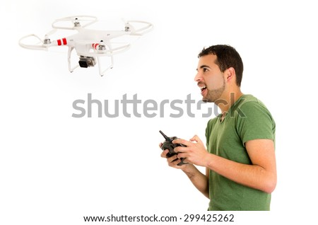 handsome young man with quadcopter drone isolated on white - stock photo