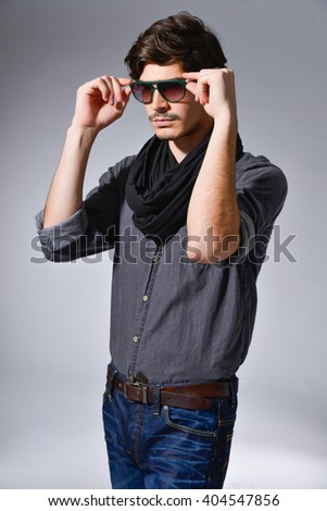 handsome young man with sun glasses - stock photo