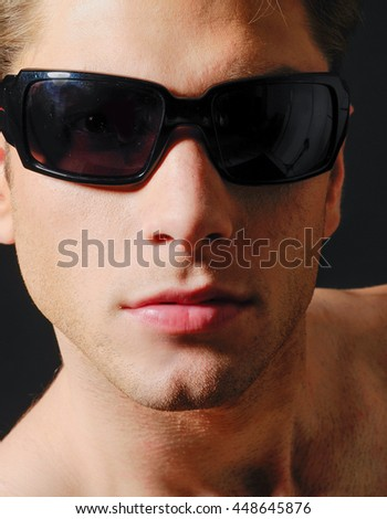 handsome young man with sunglasses-close up - stock photo