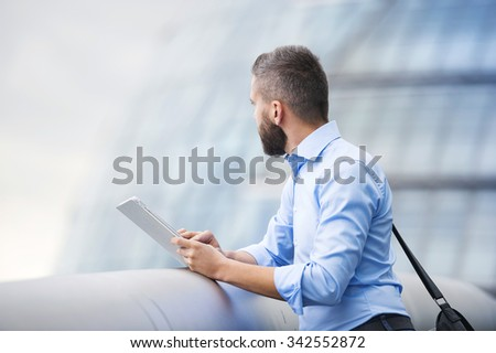 Handsome young man with tablet in the streets of London