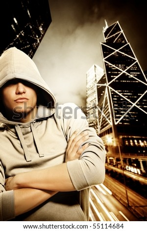 Handsome young men behind night city - stock photo