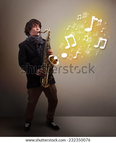 Handsome young musician playing on saxophone with musical notes - stock photo