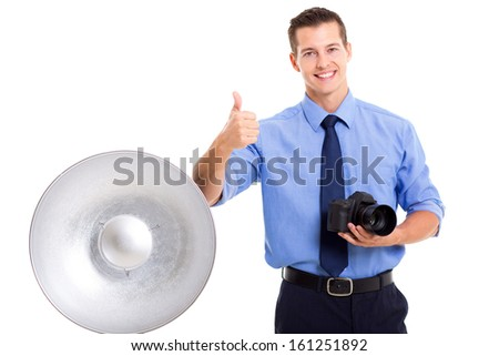 handsome young photographer giving thumb up on white background - stock photo