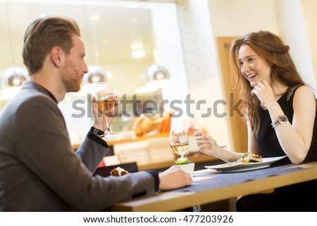 Handsome young redhair couple having dinner in the restaurant