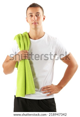 Handsome young sportsman holding towel isolated on white - stock photo