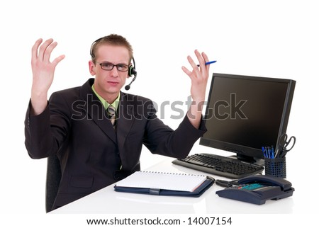 Handsome young stressed businessman making wireless phone call, service center,  white background,  studio shot.