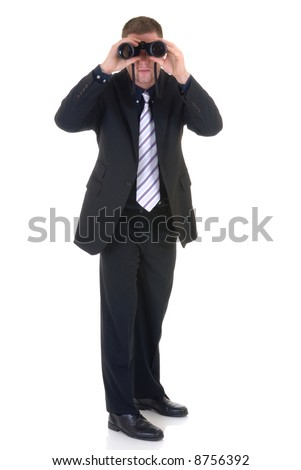 Handsome young successful businessman, binoculars in hand, white background