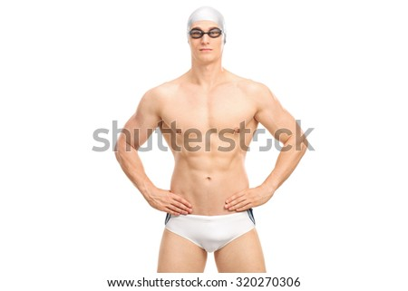 Handsome young swimmer in white swim trunks and black swimming goggles isolated on white background - stock photo