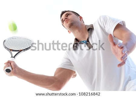 Handsome young tennis player in action, concentrating. - stock photo