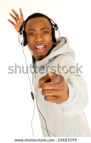 Handsome youngster, black African American teenager with headset, hip hop urban culture.  Studio white background, shallow dof - stock photo