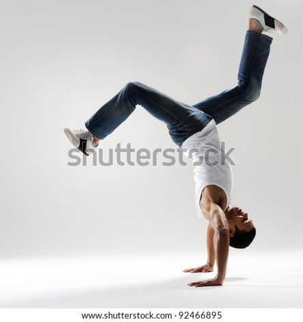 handstand dancer in mid air displaying supreme control and strength - stock photo