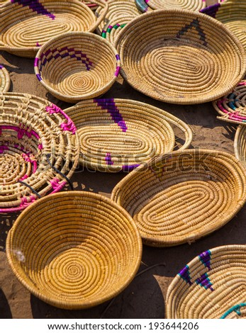 Handwoven straw African baskets, made by Masai women - stock photo
