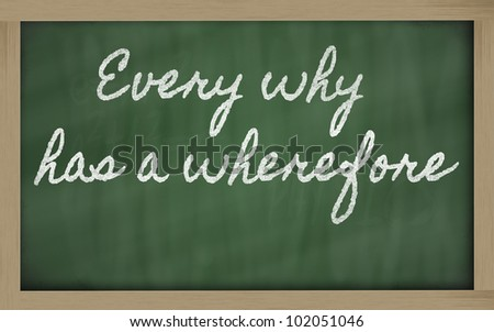 handwriting blackboard writings -  Every why has a wherefore - stock photo