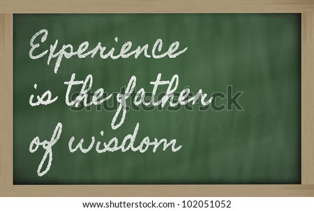 handwriting blackboard writings -  Experience is the father of wisdom - stock photo
