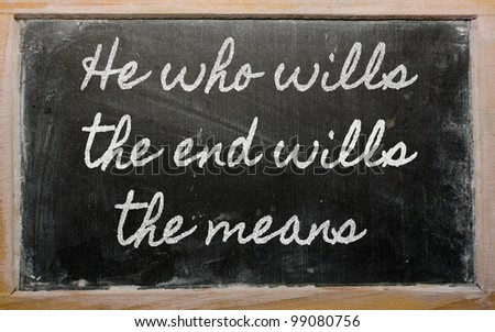 handwriting blackboard writings - He who wills the end wills  the means - stock photo