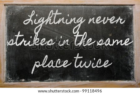 handwriting blackboard writings - Lightning never strikes in the same place twice - stock photo