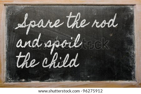 handwriting blackboard writings - Spare the rod and spoil the child - stock photo