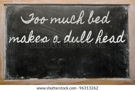 handwriting blackboard writings - too much bed makes a dull head - stock photo
