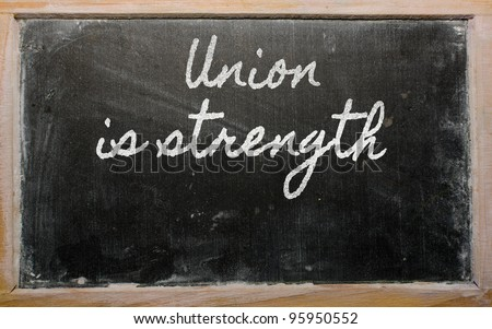 handwriting blackboard writings - Union is strength - stock photo