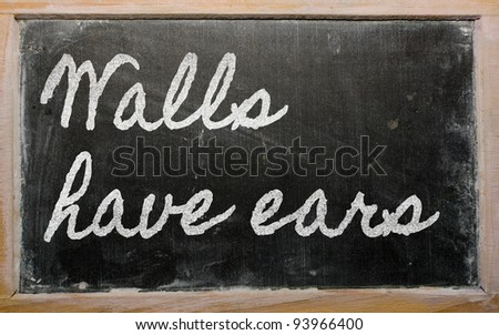 handwriting blackboard writings - Walls have ears - stock photo