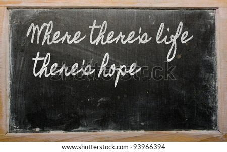 handwriting blackboard writings - 	 Where there's life there's hope - stock photo