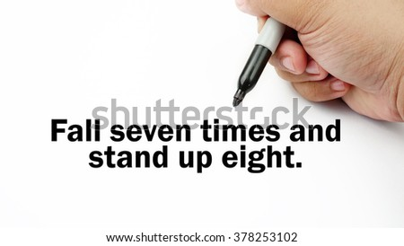 "Handwriting of inspirational motivation quotes ""Fall seven times and stand up eight"". This quotes use to motivate people to always strive for success."
