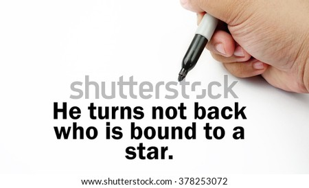 "Handwriting of inspirational motivation quotes ""He turns not back who is bound to a star"". This quotes use to motivate people to always strive for success."
